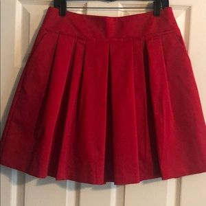 red satin skirt with side pockets